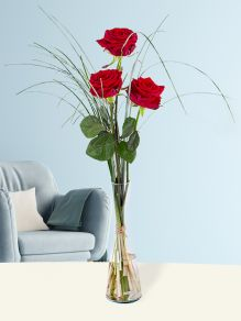 Three red roses, including vase