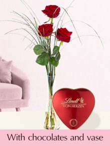 Three red premium roses, including glassvase and Lindt  heart