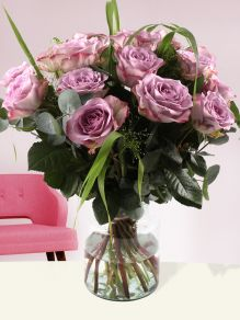 Bouquet of lavender-coloured roses with panicum and eucalyptus
