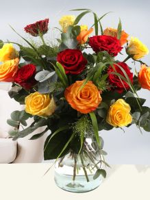 Mixed bouquet yellow-orange-red with panicum and eucalyptus