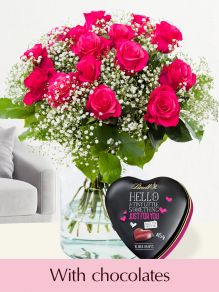 Pink Tacazzi roses with gypsophila and Lindt Hello heart
