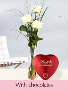 Three white roses including glassvase and Lindt