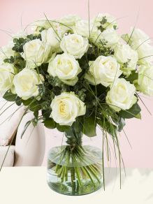 White rose bouquet with bear grass