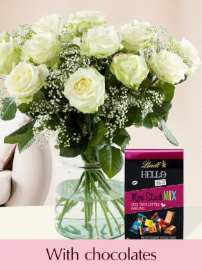 15 white roses with gypsophila and Lindt mini mix