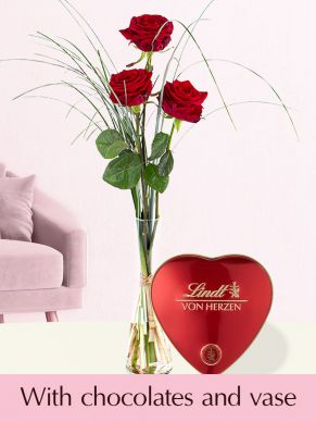 Three red premium roses, including glassvase and Lindt