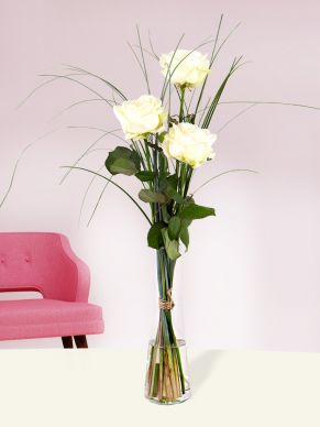 Three white roses, including vase