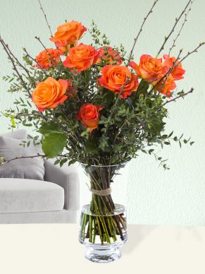 Orange rose bouquet with blossom