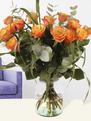 Bouquet of orange roses with panicum and eucalyptus