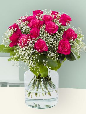 Pink Tacazzi roses with gypsophila