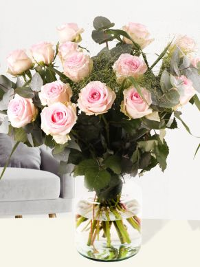 Bouquet of soft pink roses with panicum and eucalyptus