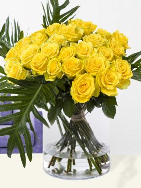 Yellow roses with botanical leaves
